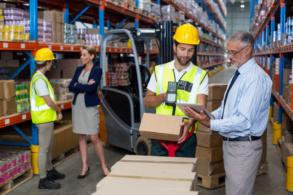 Warehouse manager holding digital tablet